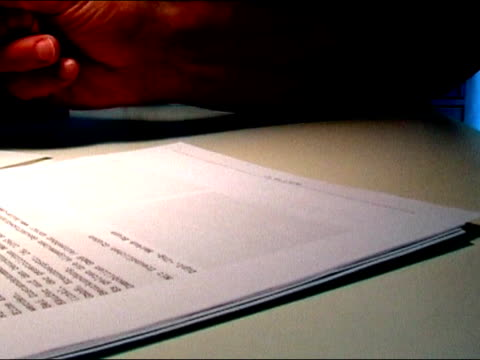 Man checking legal document and signing it video