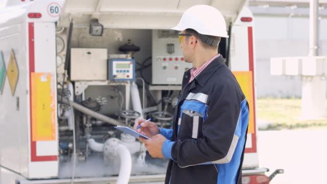 Man checking loading of liquid oxygen in tanker trailer video