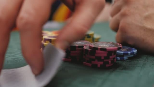A man checks cards playing poker