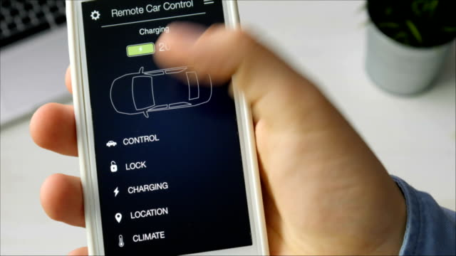 Man checks charge level of his electric car. Battery is charged. Car remote control using smartphone application fictional interface. video