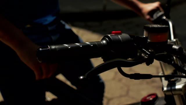 Man checks motorbike handle. video
