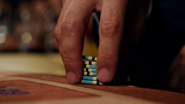Man checks out his card in poker A group of young people playing blackjack in casino. Winnings in the casino. The loss in the casino. Playing blackjack in the casino. The people at the table are betting electron micrograph stock videos & royalty-free footage