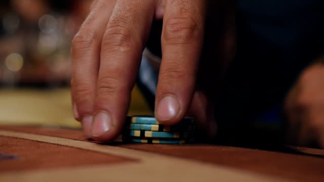 man checks out his card in poker - feltro video stock e b–roll