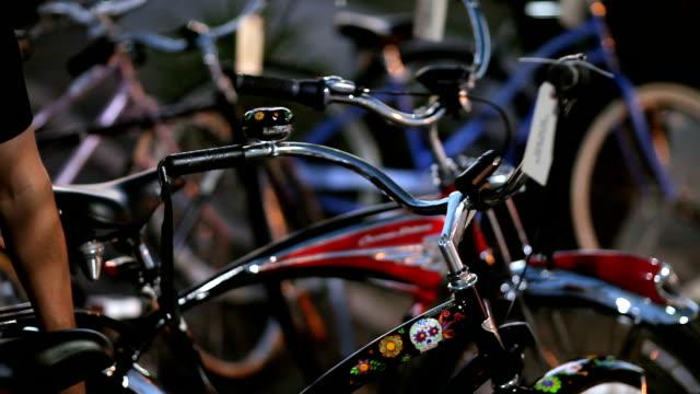 Man Checks to Make Sure Custom Bike is Locked Up. video