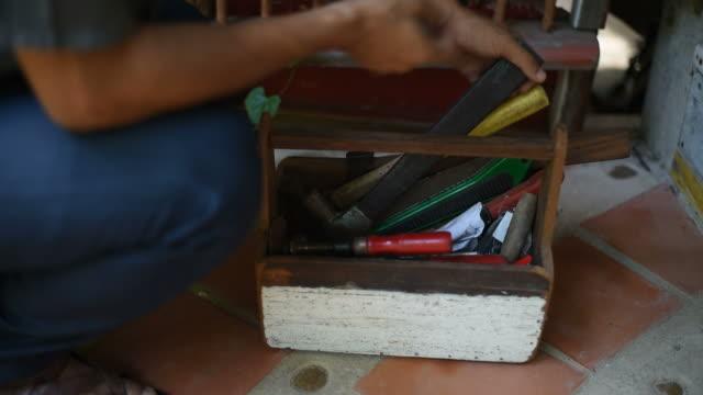 A man choosing a tools for his job. video