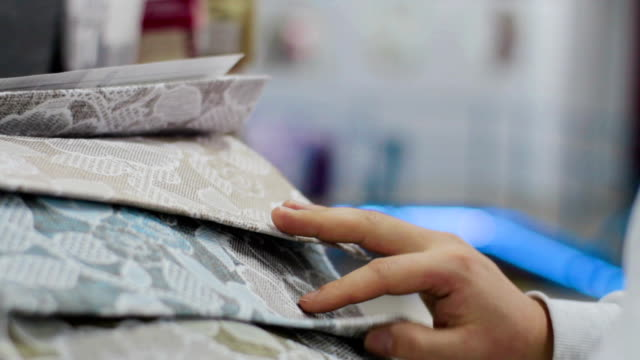 Man choosing Fabric Samples Of Different Colors for sofa Man choosing Fabric Samples Of Different Colors for new sofa fabric swatch stock videos & royalty-free footage