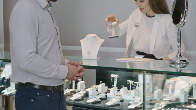Man Choosing Gift in Jewelry Store video