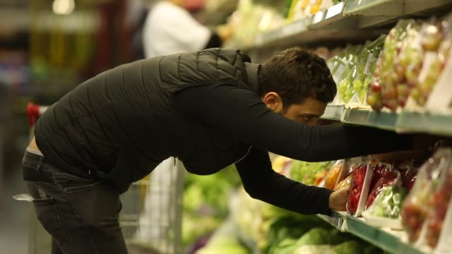 Man choosing products on supermarket video