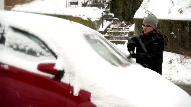 Man Cleans Snow off Car video