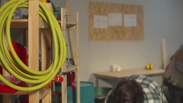 en man rengör hyllorna i källaren - working from home bildbanksvideor och videomaterial från bakom kulisserna