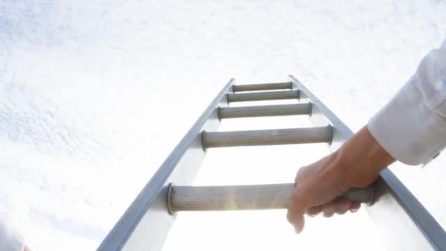 stockvideo's en b-roll-footage met een man klimmen een ladder - ladder