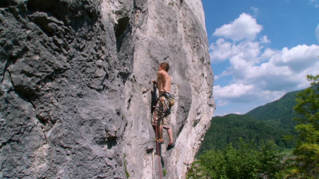 HD CRANE: Man Climbing A Rock video