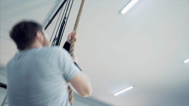 Man climbing a rope. video