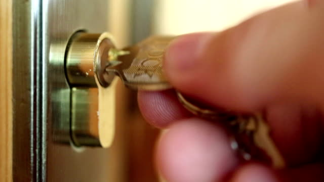 man closes door  to the key - chiave video stock e b–roll