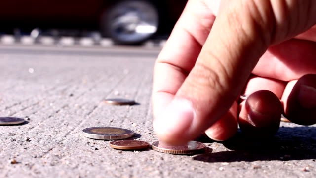 man collect coins on street man collect coins on street concrete us coin stock videos & royalty-free footage