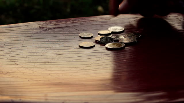 man collect coins on table man collect coins on table us coin stock videos & royalty-free footage