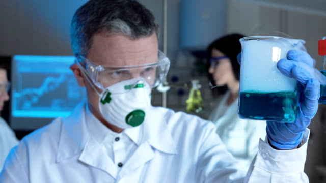 Man conducting chemical reaction video