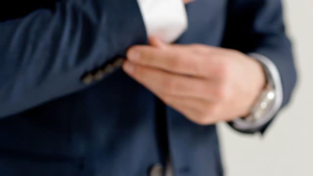 Man corrects shirt cuff video
