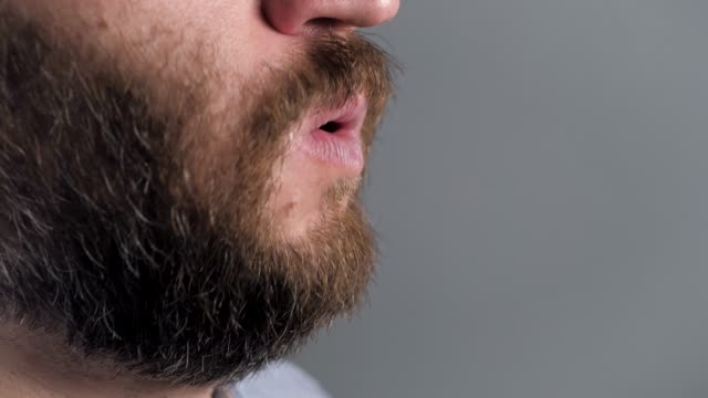 Man coughs and covers her mouth with napkin. Colds, flu, laryngitis, tuberculosis, asthma, bronchitis, allergies, pneumonia, APF inhibitors, nasopharyngeal leakage concepts. Side view. Close-up Guy coughs and covers her mouth with napkin. Colds flu laryngitis, tuberculosis, asthma, bronchitis, allergies, pneumonia, APF inhibitors, nasopharyngeal leakage, concepts. Side view. Close-up emphysema stock videos & royalty-free footage