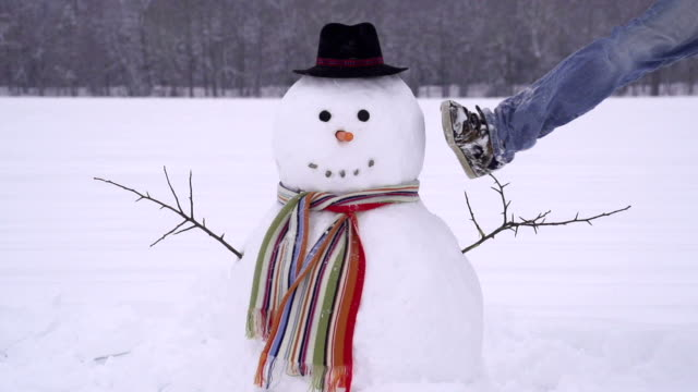 Man crushing a snowman Young man jumping into a snowman snowman stock videos & royalty-free footage