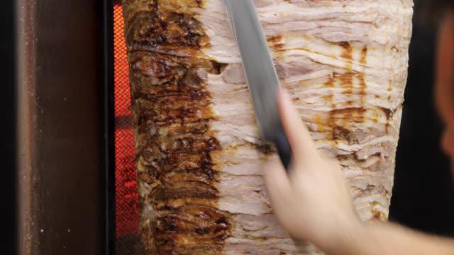 Man cutting gyro in fast food restaurant video