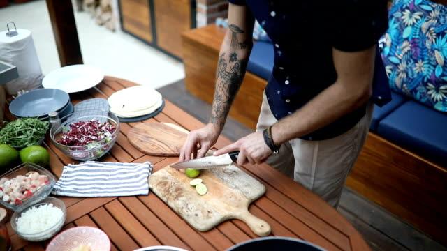 Man cutting lime