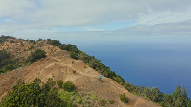 AERIAL WS Man cycling on mountain path / Canary Islands, Spain