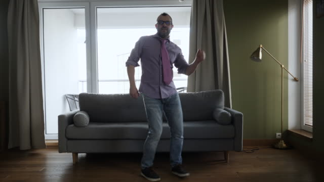 Man Dancing at Home Living Room, Fun Celebrating Funny Viral Dance Freedom Weekend. Happy Young Guy Enjoying Shuffle Dance, Having Fun Party. Joyful Man Dancing Cheerful In Living Room. Happy People. Man Dancing at Home Living Room, Fun Celebrating Funny Viral Dance Freedom Weekend. Happy Young Guy Enjoying Shuffle Dance, Having Fun Party. Joyful Man Dancing Cheerful In Living Room. Happy People. ecstatic stock videos & royalty-free footage