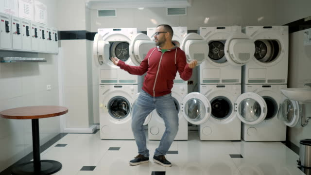 Man Dancing Swing And Have Fun In the Laundry  Room. Happy Man Enjoying Dance, Having Fun Together, Party. Floss Dance Viral, Flossing, swing.