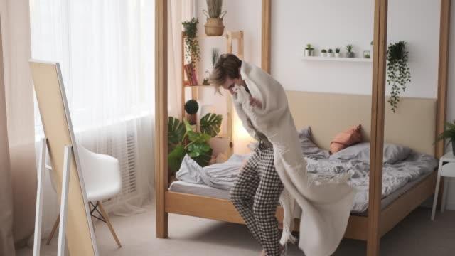 man dancing with blanket in bedroom - pajamas stock videos & royalty-free footage