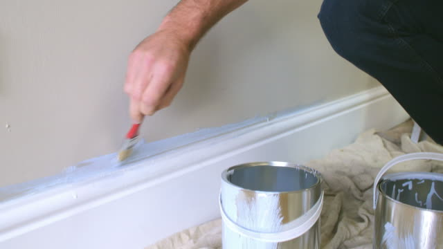 Man Decorating Room Using Paintbrush video