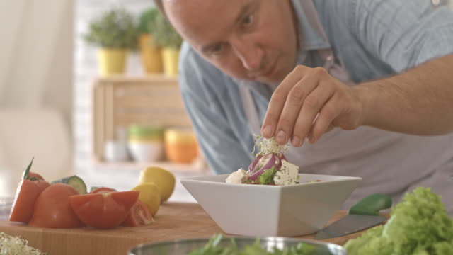 Man decorating vegetable salad with sprouts video