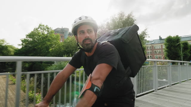 Man delivering food by bike in the city