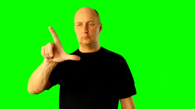 A man depicts the gestures of the virtual screen. A man depicts the gestures of the virtual screen. This footage contains solid green instead alpha channel, so you can easy make keying and compositing in many software. Tap scroll swipe hold gestures. focus on foreground stock videos & royalty-free footage
