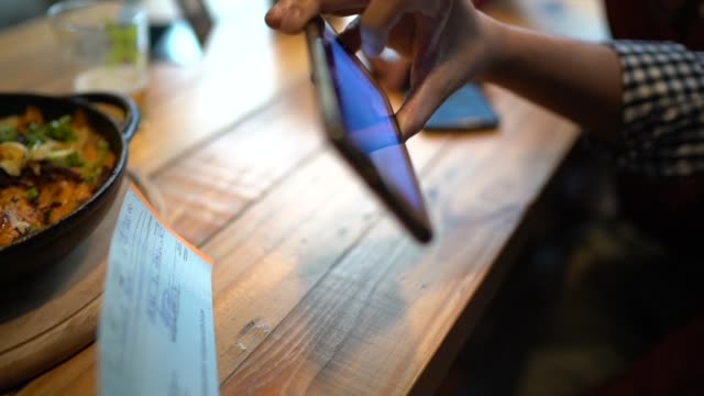 Man depositing check by phone in the restaurant video