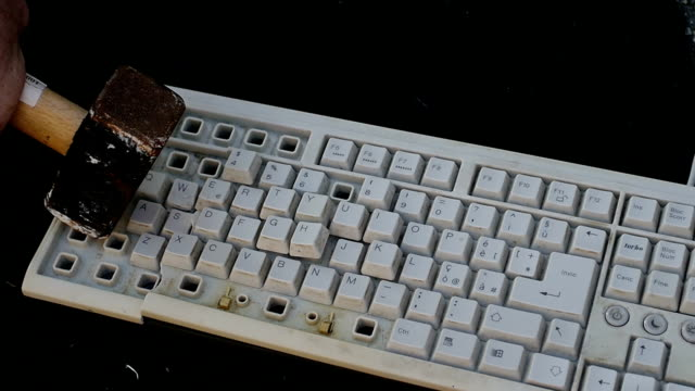 man destroying keyboard with hammer: violence, outburst, anger, computer, pc video
