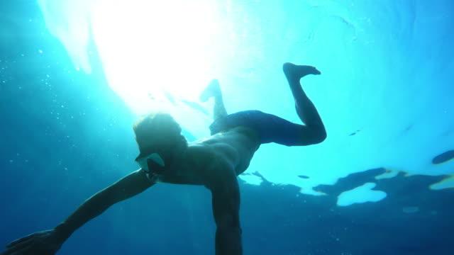 POV Man diving to the sea bottom video