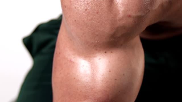Man doing arm curls video