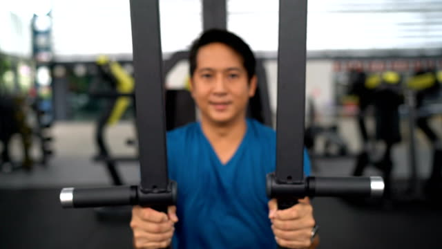 Man doing chest exercise by using workout machine video