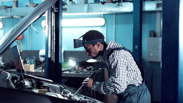 Man doing engine service video