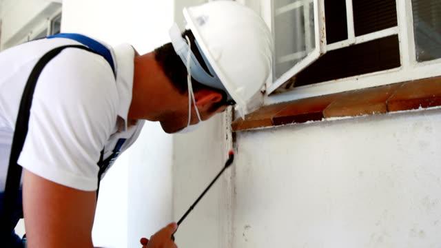 Man doing pest control video