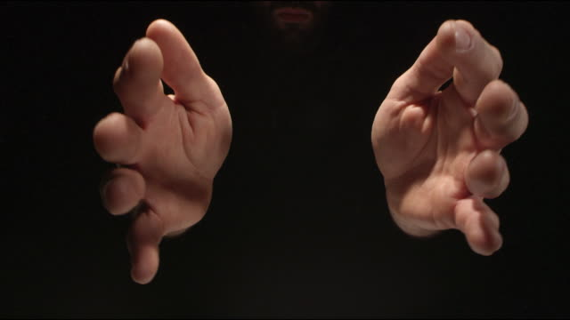 Man drawing hands towards camera. Reaching and grabing imaginary object video