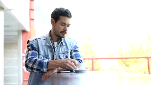 Man drink coffee in cafe video