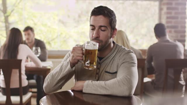Man drinking beer video