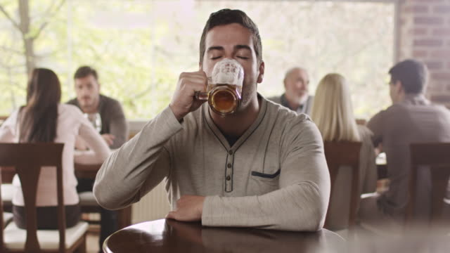 Man drinking beer Young man drinking beer tasting stock videos & royalty-free footage