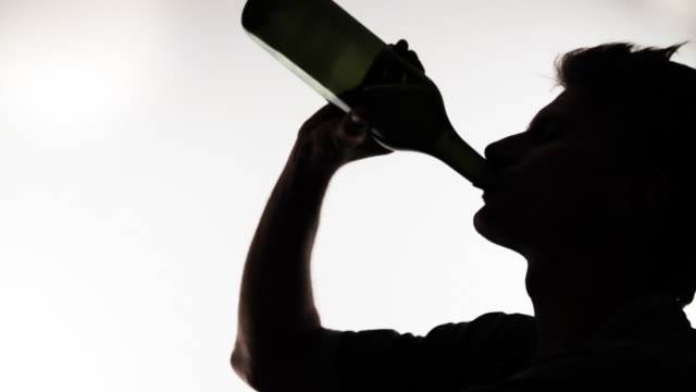 HD: Man Drinking From Wine Bottle video