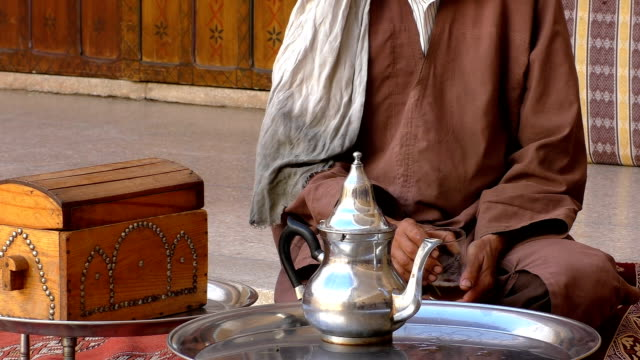 Man drinking his tea at home in Morocco video
