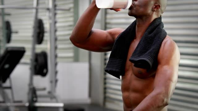 Man drinking protein shake at gym gym video