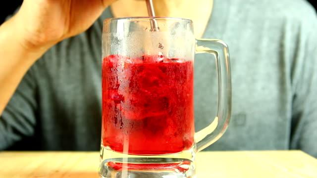 man drinking  red sweet drink - summer background filmów i materiałów b-roll