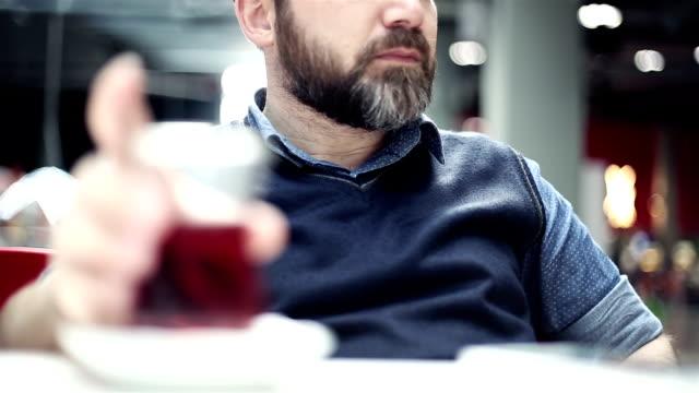 man drinking tea at cafe - cultura turca video stock e b–roll